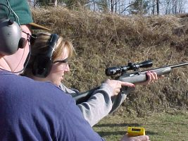 A CFSC instructor acting as Range Officer for a Mini-Rifle competitor.